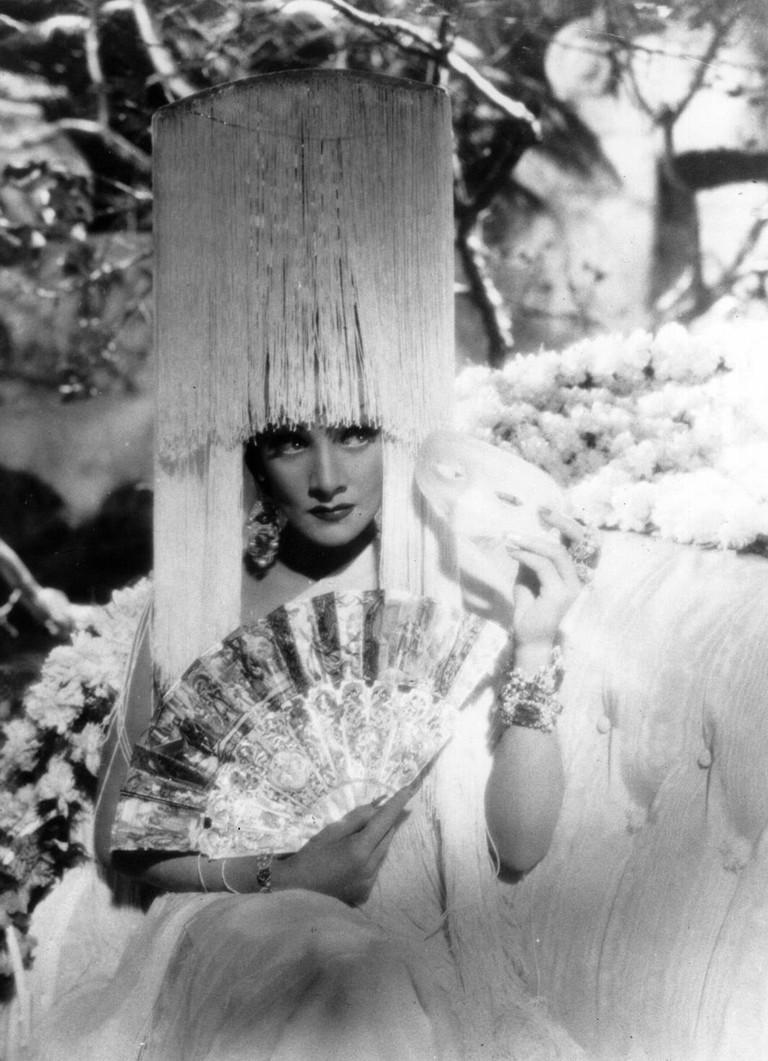 """Marlene Dietrich, fully accessorized by Travis Banton, in Sternberg's """"The Devil Is a Woman"""" (1935)"""