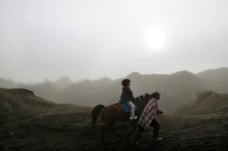 Riding a horse in Mount Bromo, Indonesia
