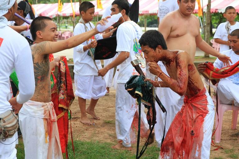 Washing off the blood Phuket Vegetarian Festival 2010