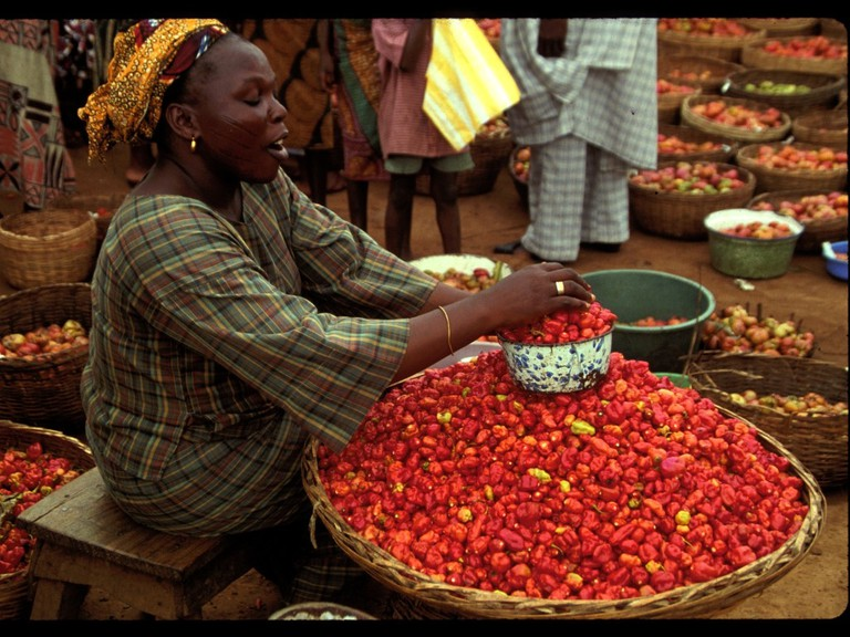 Woman selling pepper in a local market
