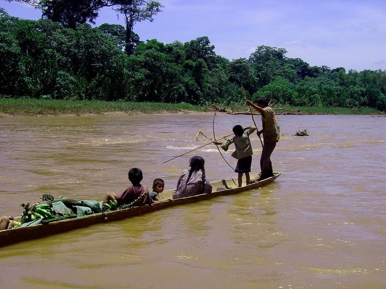 A Tsimane father teaching his boy to fish