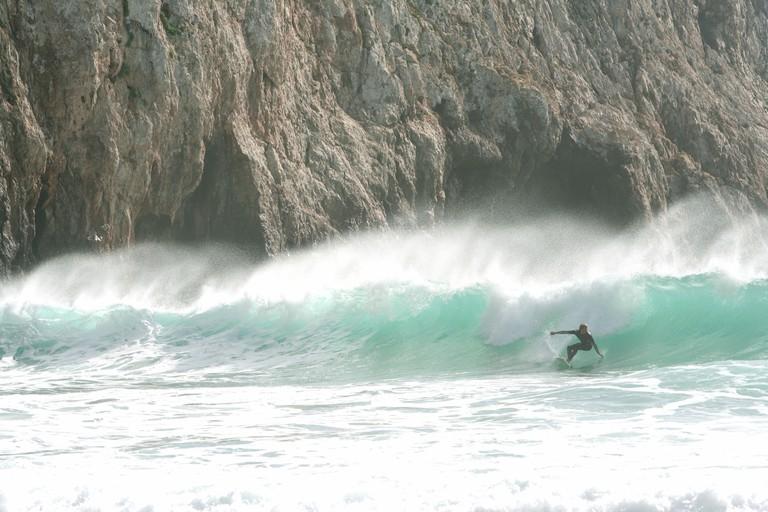 Surfer at Praia de Beliche beach, Sagres, Portugal