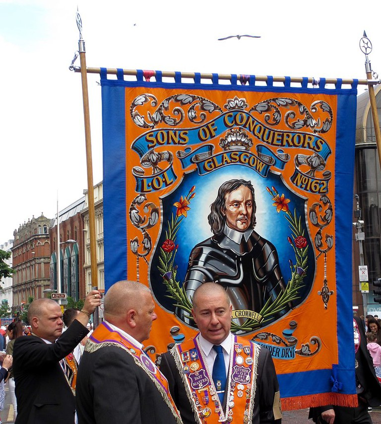 Orangemen carrying a banner with the likeness of Oliver Cromwell