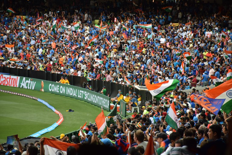 A full house cheering for India during a cricket match