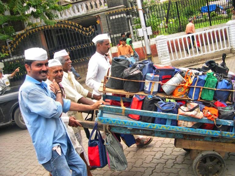 Dabbawalas on their way to deliver tiffins