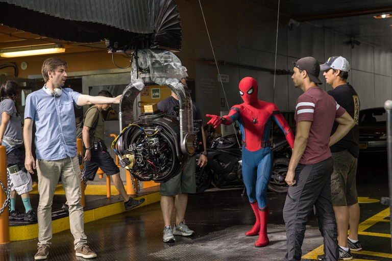 Director Jon Watts with cast and crew on the set of Columbia Pictures' 'Spider-Man: Homecoming'
