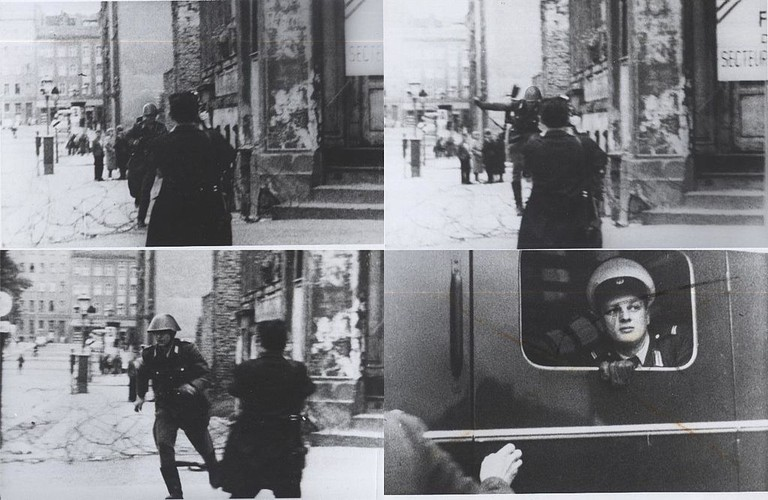 East German guard Conrad Schumann jumps to freedom in West Berlin