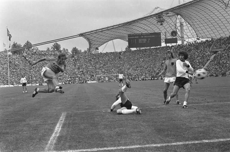 The football World Cup with West Germany playing the Netherlands. The scoreboard at Munich's Olympic Stadium reads 2-1 to West Germany, which was also the final score