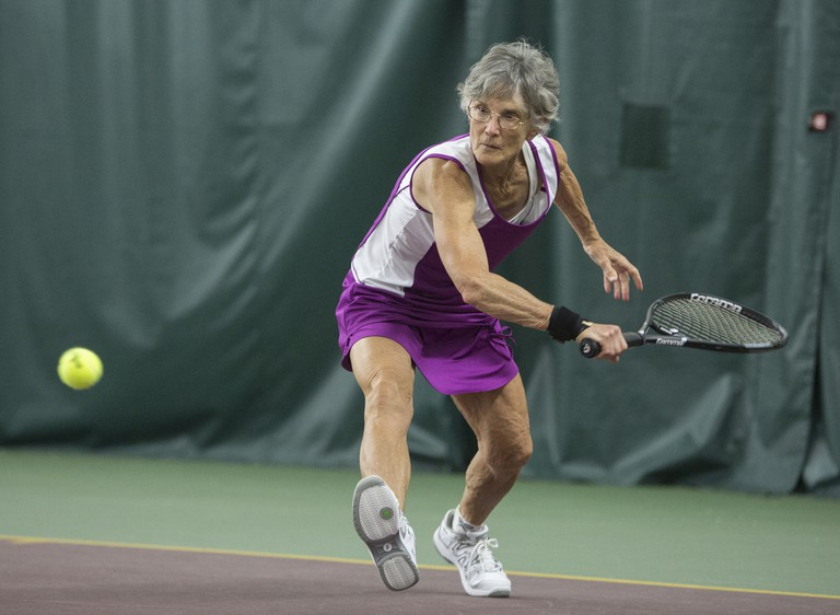 Michelle Immler, 66, wins a women's singles tennis match at the 2015 Games.