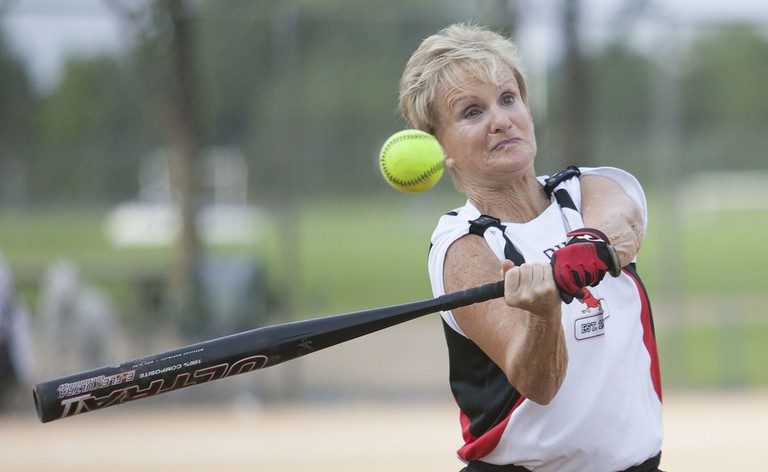 Betty Brenner of OH Cardinals bats in a game against Senior Moments at the 2015 Games.