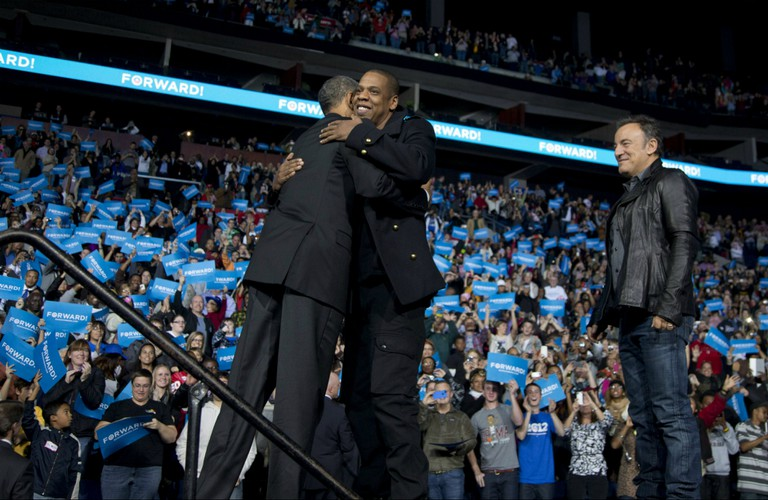 Barack Obama and Jay Z embrace
