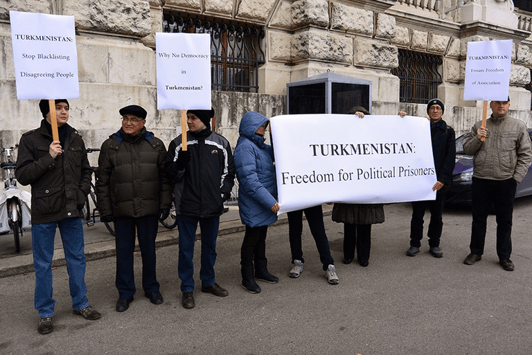Protesters at the Hofburg Palace during a convening of the OSCE Permanent Council, attended by a Turkmen official. Vienna, 2014