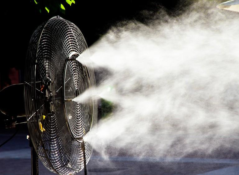 A fan spritzing water vapour