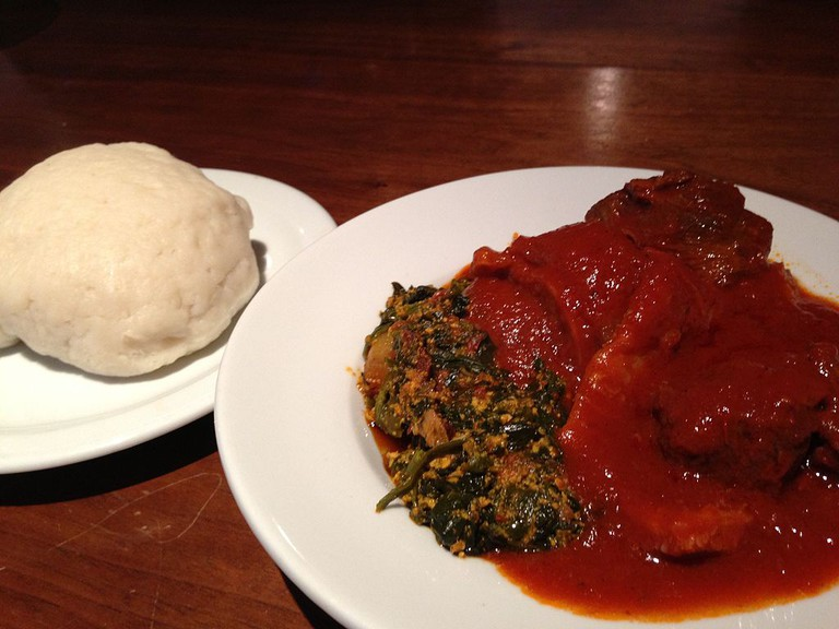 A plate of pounded yam and egusi soup. / Toludpilgrim / Wikimedua https://upload.wikimedia.org/wikipedia/commons/1/1e/A_Plate_of_Pounded_Yam_%28Iyan%29_served_in_Birmingham_UK.JPG