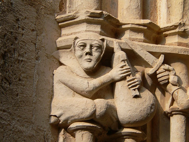 Medieval bagpiper at the Cistercian monastery of Santes Creus, Catalonia, Spain