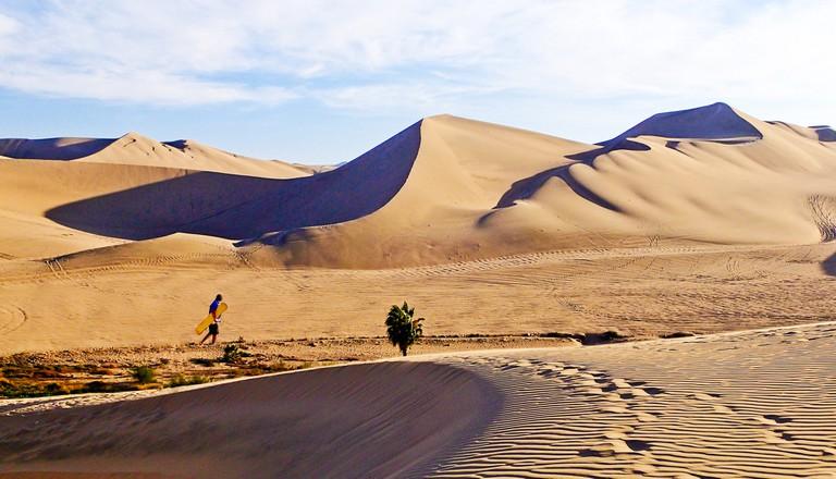 Sand boarding in Huacachina, Peru