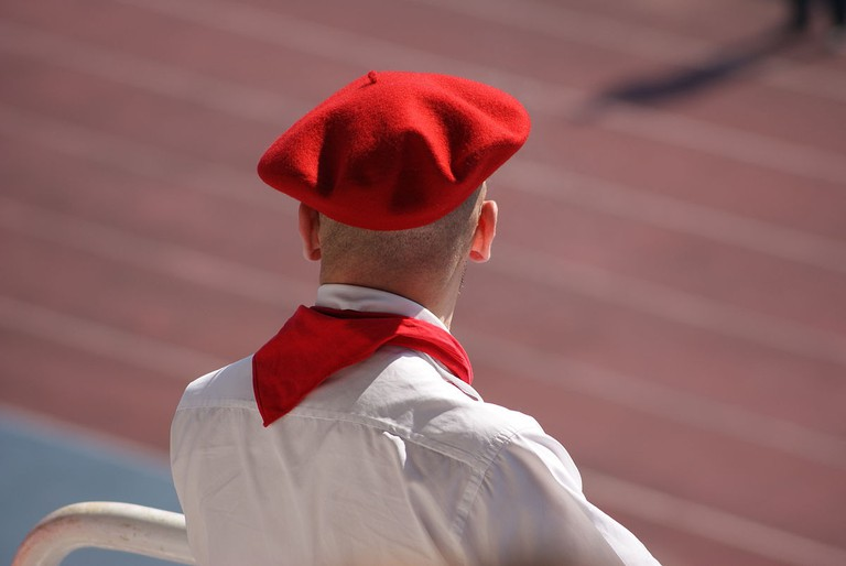 A Biarritz rugby team supporter wearing the traditional colors of the Basque region