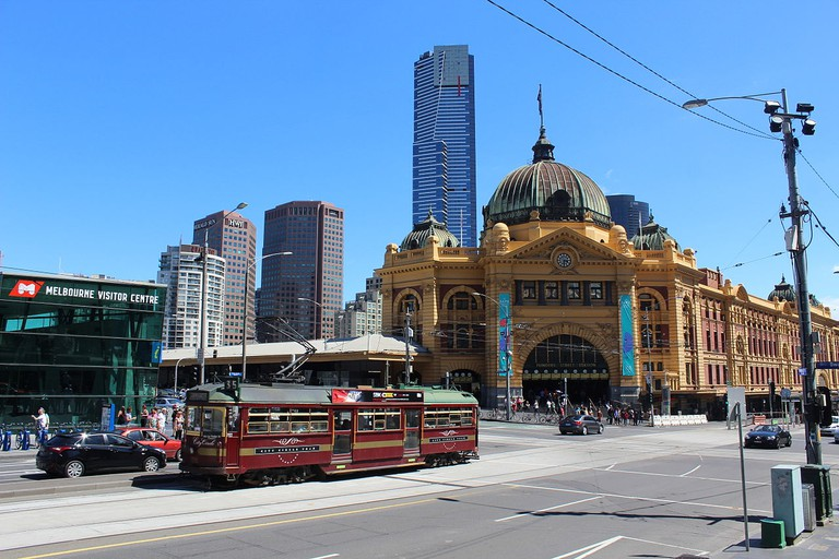 Flinders Street, passing Federation Square and Flinders Street Station