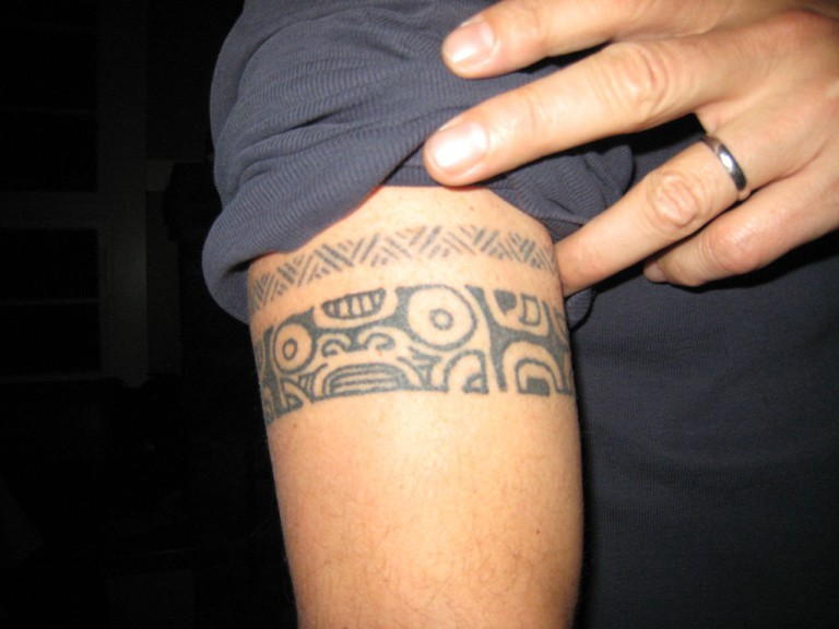 Celebrity chef Anthony Bourdain shows off his Tahitian tattoo