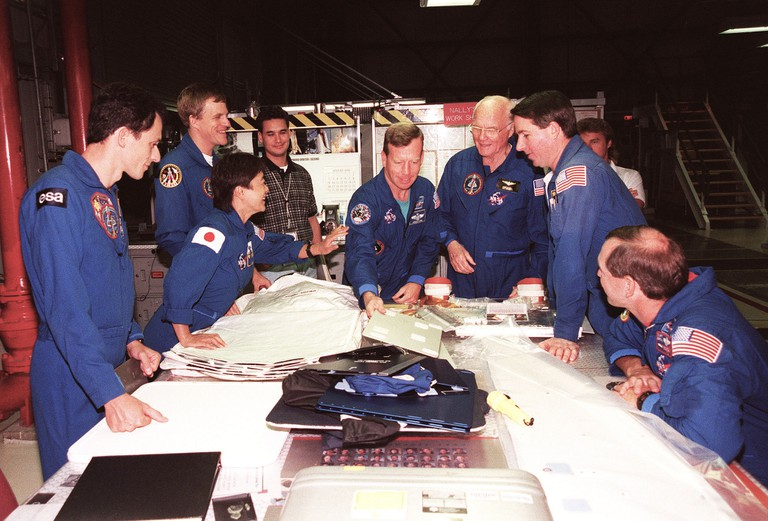 Mukai (pictured second from the left) was the only female crew member of mission STS-95