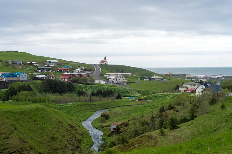 Village church overlooks ocean in Iceland | © pml2008/Flickr