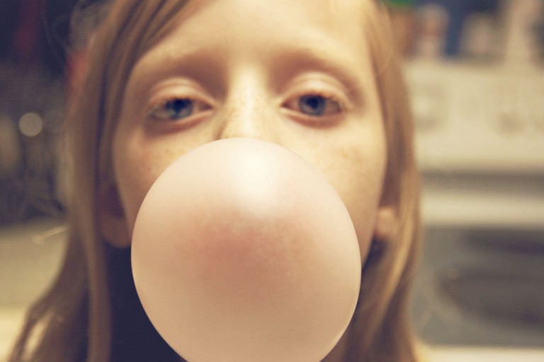 Girl Blowing Gum