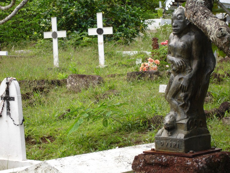 A sculpture on the grave of Paul Gauguin