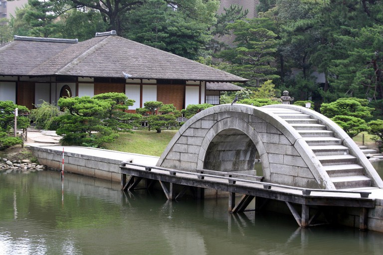 Bridge over pond at Shukkeien Garden