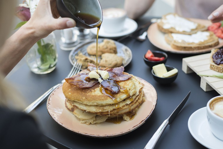 A generous helping of bacon pancakes, one of Texas Coffee's many American-style breakfast options | courtesy of Texas Coffee