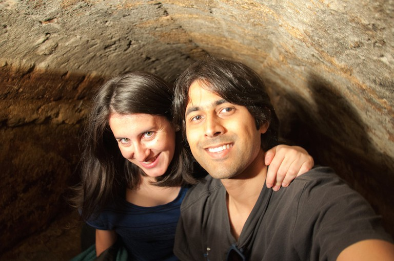 Ashray and Zara from BackpackMe inside Lisbon's Roman Tunnels