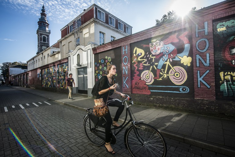 Cyclist in Ghent | courtesy of Visit Ghent