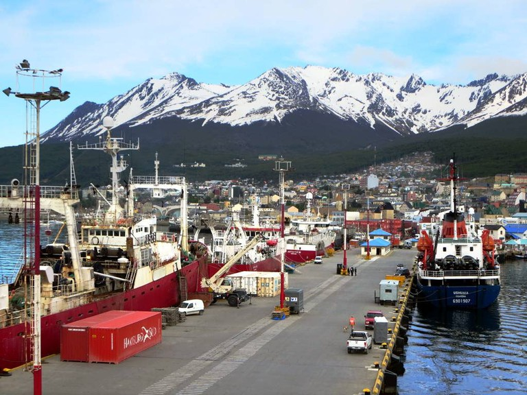 Boats in the Ushuaia harbour with incredible mountains in the background