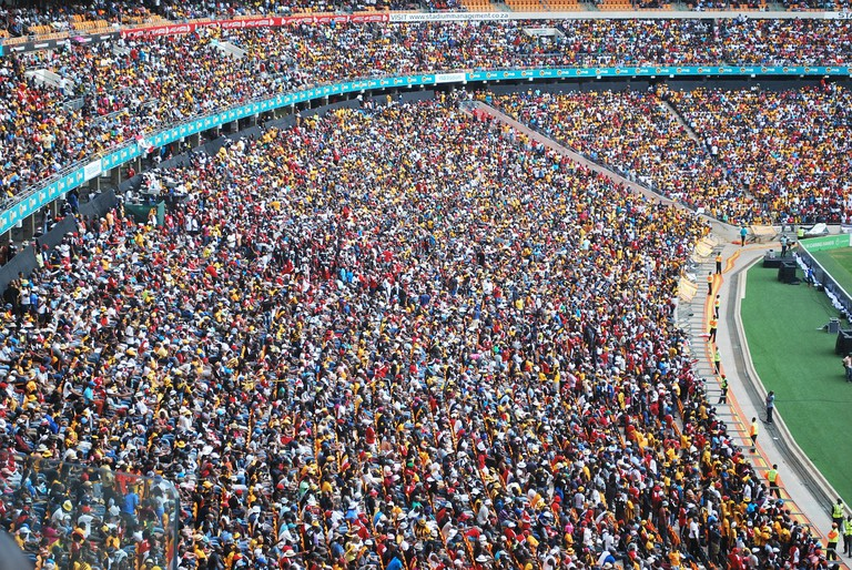 Fans watching football at a South African stadium