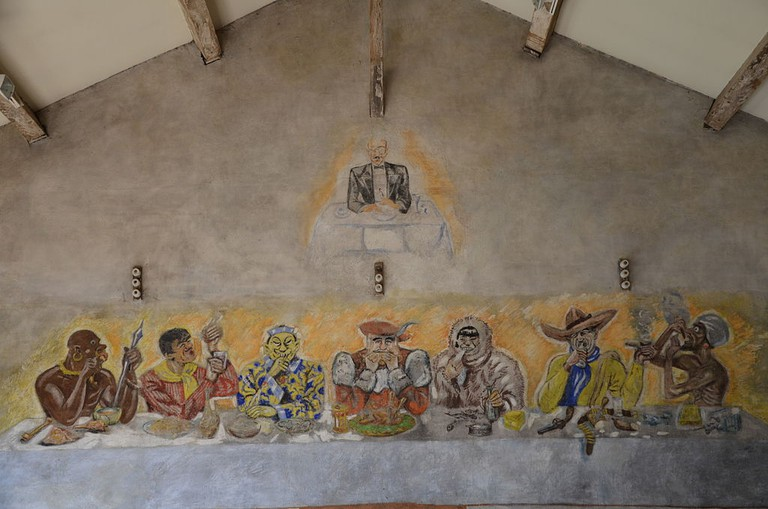 The camp was home to many artists so the walls are lined with frescoes and political messages