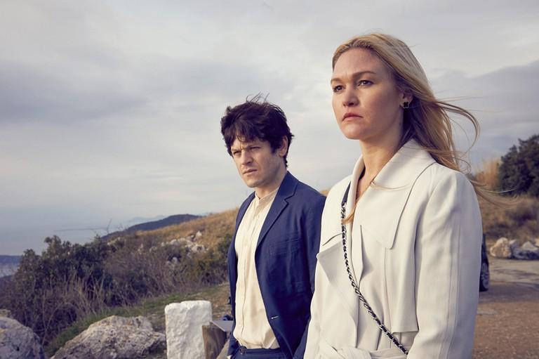 Julia Stiles as Georgina and Iwan Rheon as Adam Clios