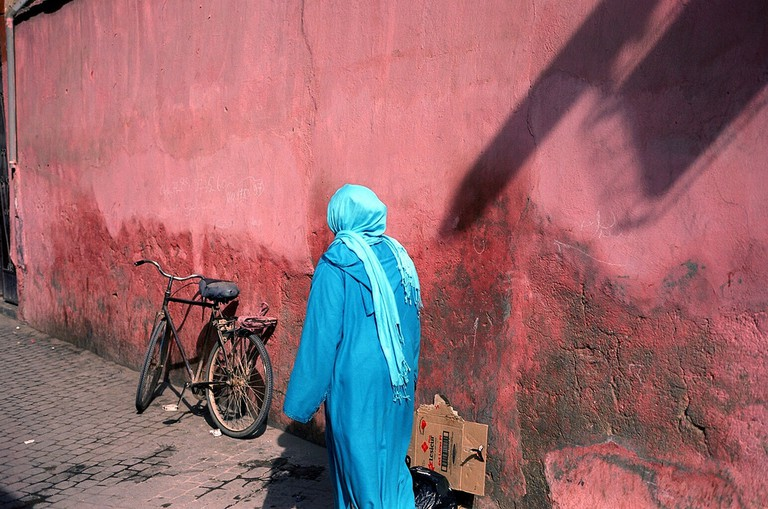 Lady walking through the streets of a Moroccan medina