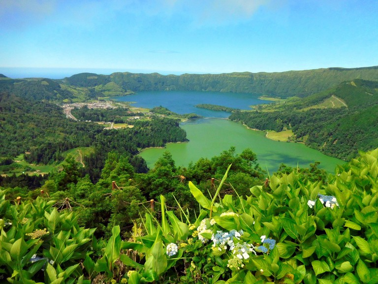 Don't leave without seeing the blue and green lakes in Sete Cidades.