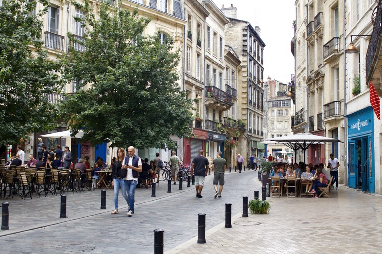 People strolling through the streets of Bordeaux/
