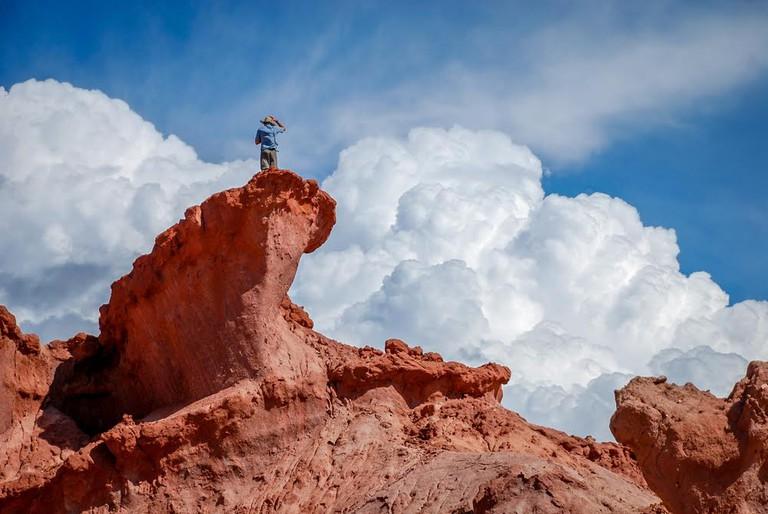 Man on top of a rock formation at Natural Reserve, Quebrada del rio de las Conchas, Cafayate, Salta, Argentina
