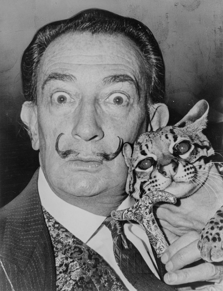 Salvador Dali with Babou, the ocelot, and cane