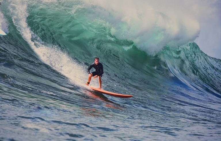 Surfer riding large Waimea waves