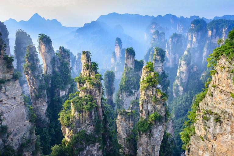 https://www.shutterstock.com/image-photo/landscape-zhangjiajie-taken-old-house-field-449250082?src=oJRWSEmrzssEaoEldFu3lQ-1-0