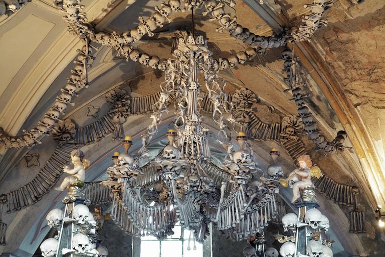 Chandelier made of bones and skulls in Sedlec ossuary, Czech Republic