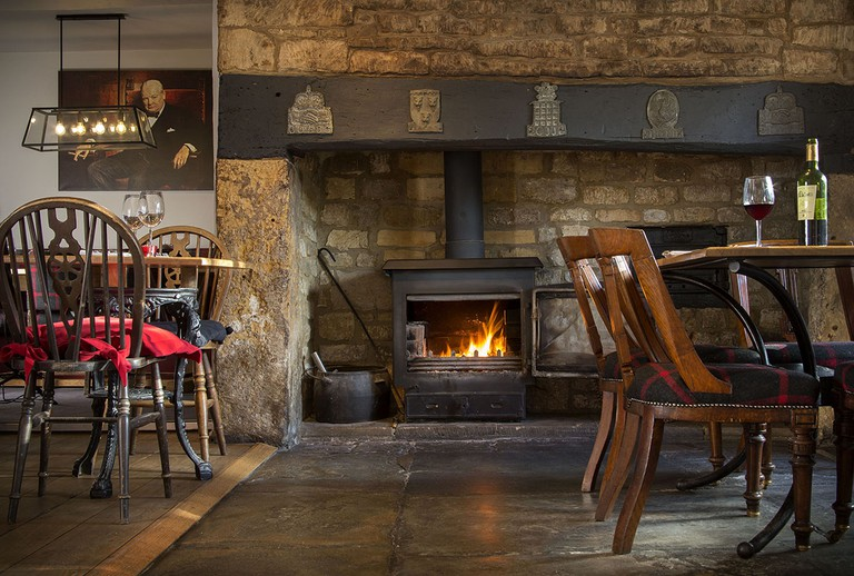 In front of the fire | © The Churchill Arms
