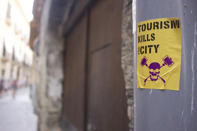 Anti-tourism sticker © Leon Beckenham