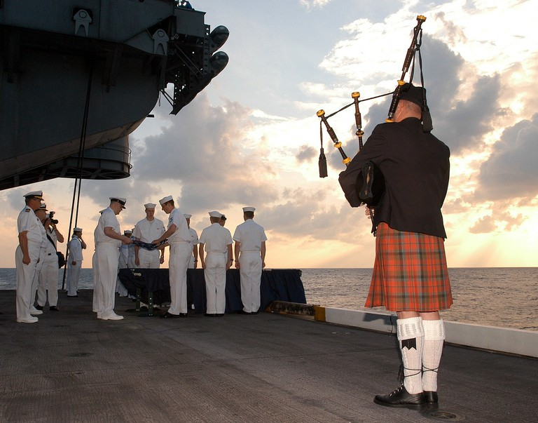 Burial Ceremony With Bagpipes Aboard The USS Enterprise
