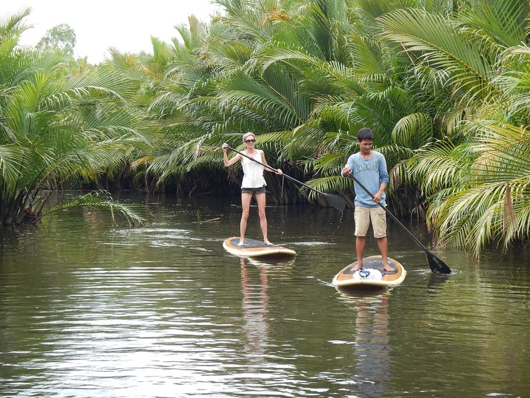 Stand-up paddleboarding in Kampot