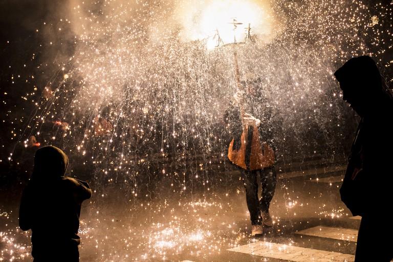 A firework bearer at the correfoc © Josep Enric