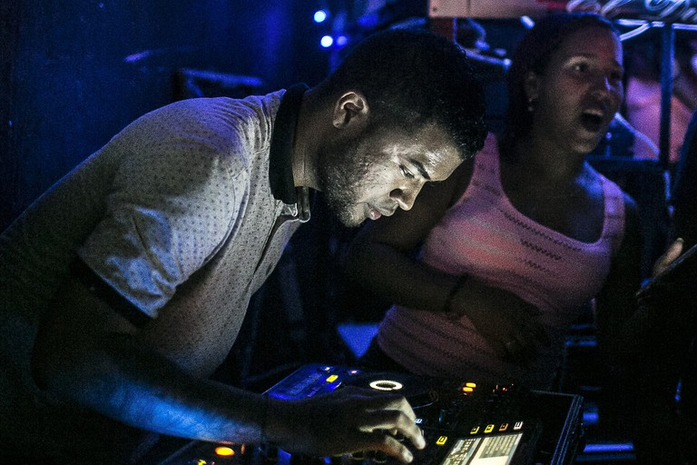 DJs work hard to put on the loudest and most popular parties in town through their sound-systems