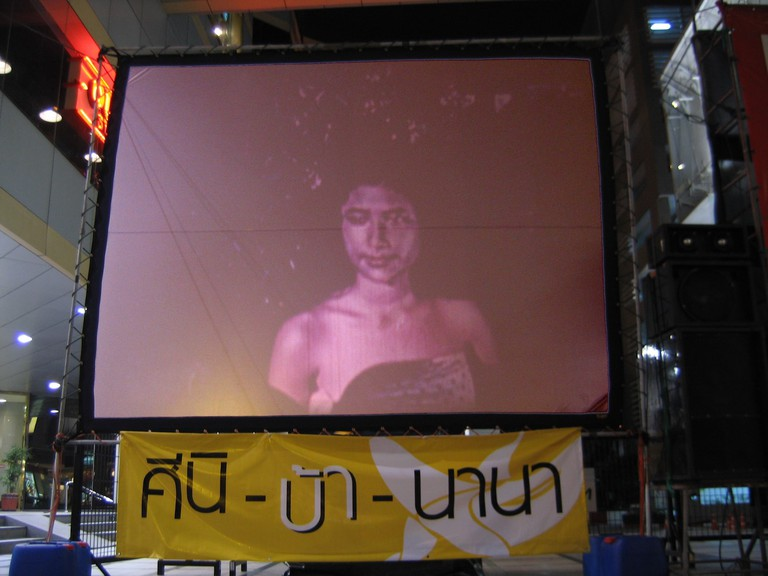 A large screen shows soap operas in Bangkok